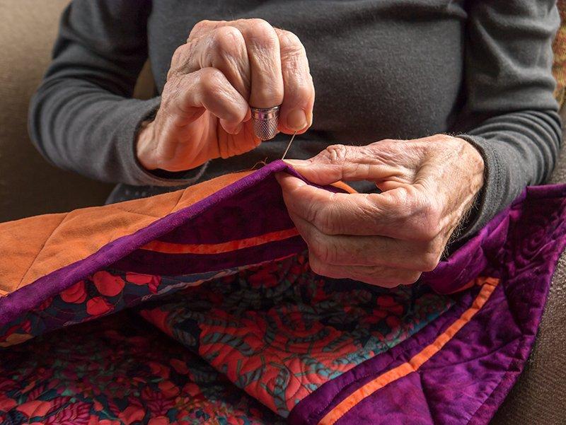 Elderly Woman Quilting